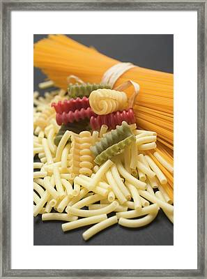 A Bundle Of Spaghetti And Various Types Of Coloured Pasta Framed Print