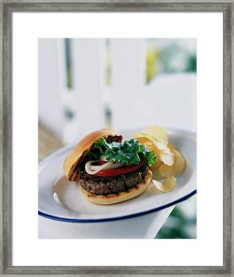 A Burger With Potato Chips Framed Print by Romulo Yanes