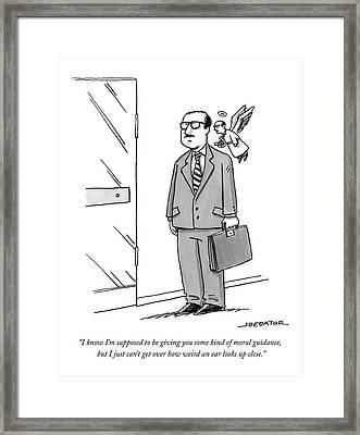 A Businessman Stands By A Door Framed Print