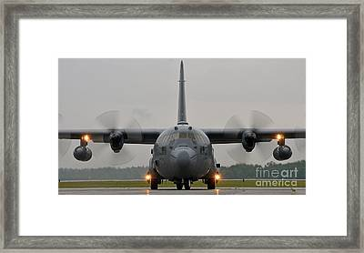 A C-130 Hercules Taxis On The Flight Line Framed Print