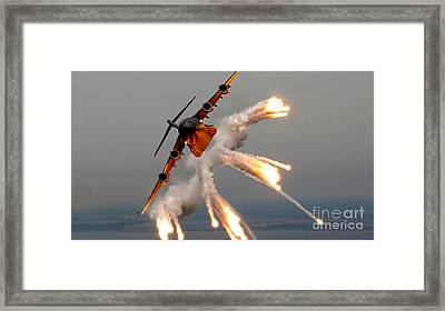 A C-17 Globemaster IIi Releases Flares Framed Print by Celestial Images