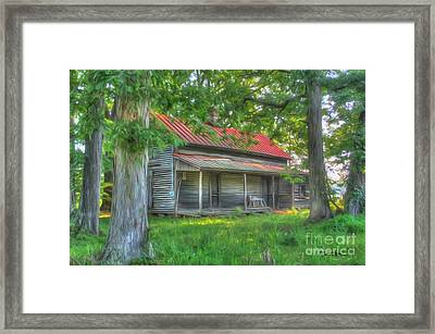 A Cabin In The Woods Framed Print by Dan Stone