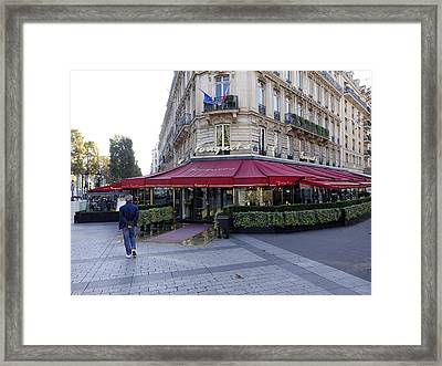 A Cafe On The Champs Elysees In Paris France Framed Print