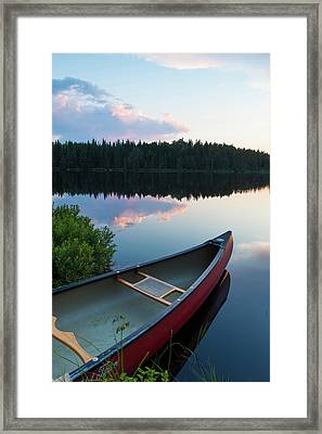 A Canoe On Little Berry Pond In Maine's Framed Print by Jerry and Marcy Monkman
