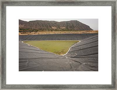A Capture Pond On A Landfill Site Framed Print by Ashley Cooper