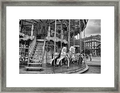A Carousel Scene In Paris Framed Print