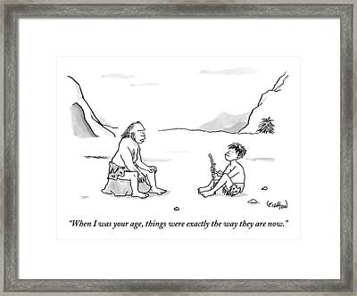 A Cave Dweller Speaks To His Son Who Is Holding Framed Print
