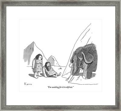 A Caveman And A Cavewoman Wait For An Iced Wooly Framed Print