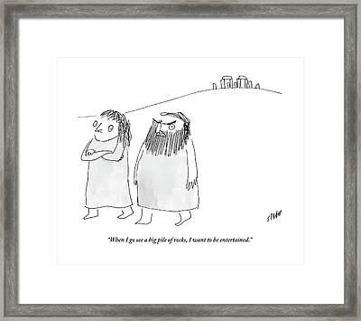 A Caveman Man Grumpily Talks To His Cavewoman Framed Print