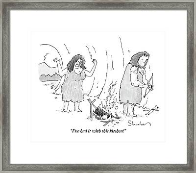 A Cavewoman Raises Her Arms In Anger Framed Print by Danny Shanahan