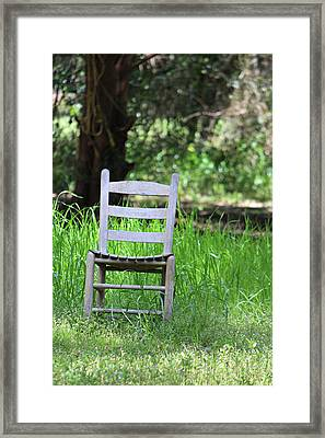 A Chair In The Grass Framed Print by Lynn Jordan
