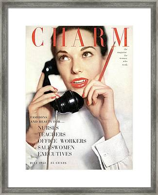 A Charm Cover Of A Model Holding A Telephone Framed Print by Ernst Beadle