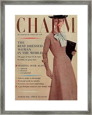 A Charm Cover Of A Model In Designer Clothing Framed Print by Louis Faurer