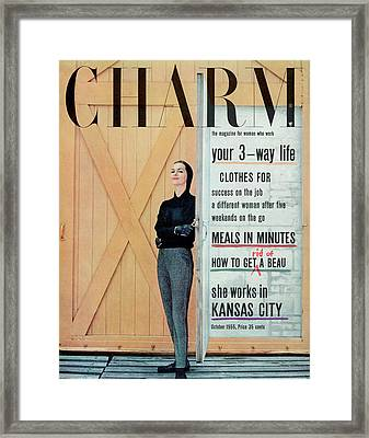 A Charm Cover Of A Model Opening A Door Framed Print by Carmen Schiavone