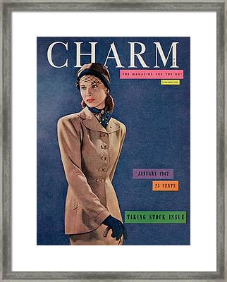 A Charm Cover Of A Model Wearing A Swansdown Suit Framed Print by Fritz Henle
