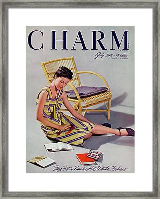 A Charm Cover Of A Model With Books Framed Print by  Farkas