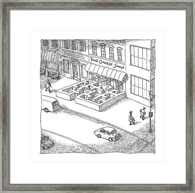 A Cheese Shop Has The Exterior Of A Mouse Maze Framed Print