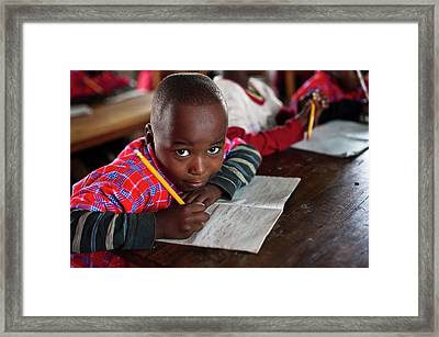 A Child In A Literacy Class Framed Print