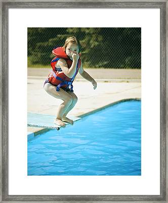 A Child Jumps Off Diving Board Framed Print by Kelly Redinger