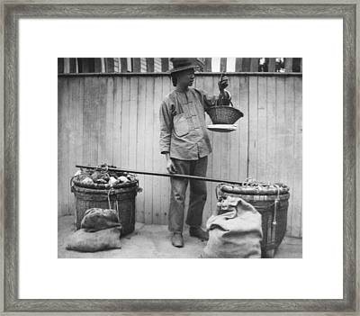 A Chinese Fruit Vendor Framed Print by Underwood Archives