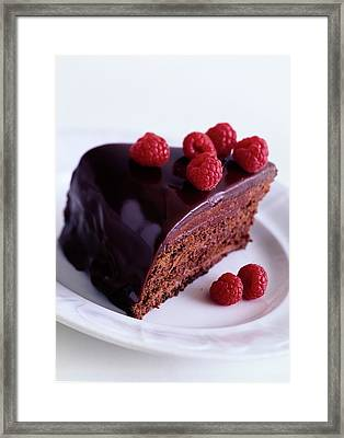 A Chocolate Pecan Cake With Raspberries On Top Framed Print