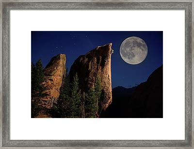A Climber Ascends A Rock Formation Framed Print