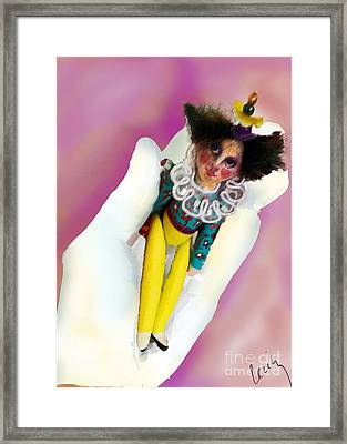 A Clown In The Hand Framed Print