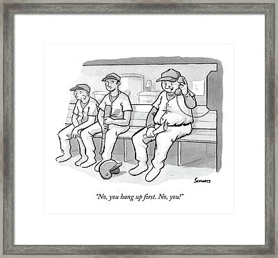 A Coach In A Baseball Dugout Speaks On The Phone Framed Print