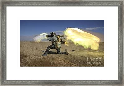 A Coalition Force Member Fires A Carl Gustav Recoilless Rifle System Framed Print by Paul Fearn