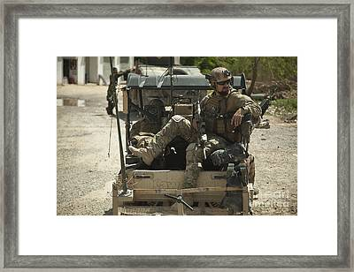 A Coalition Forces Member Maintains Framed Print