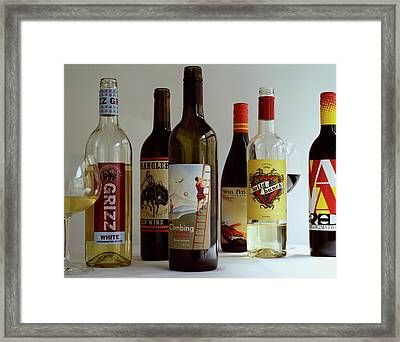 A Collection Of Wine Bottles Framed Print by Romulo Yanes