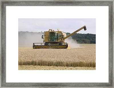 A Combine Harvester In Weybourne Framed Print by Ashley Cooper