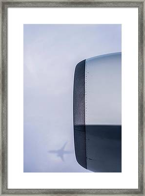 A Commercial Jet Casts A Shadow Framed Print