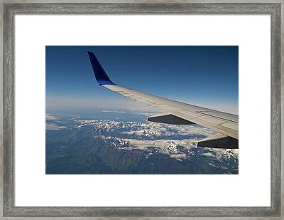 A Commercial Jet Flies Framed Print