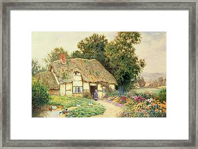 A Cottage By A Duck Pond Framed Print