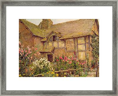 A Cottage Garden In Cholstry Framed Print by Ernest Arthur Rowe