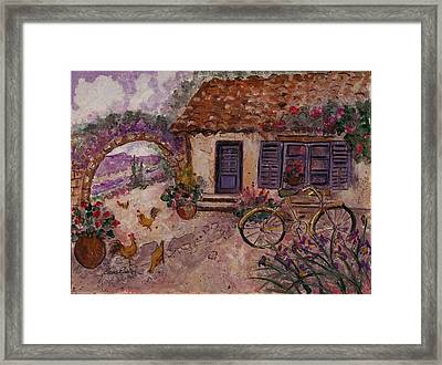 A Cottage In Provence Framed Print