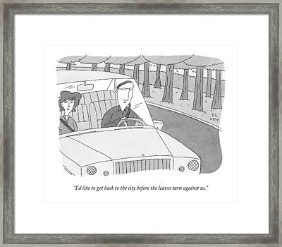 A Couple Drives Along A Forest Road Framed Print
