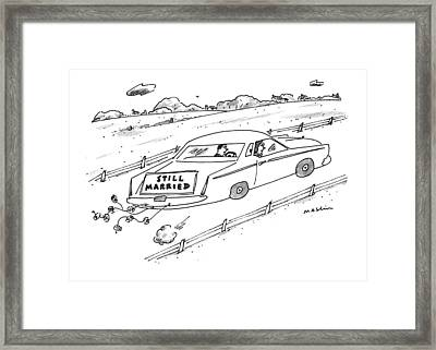 A Couple Driving A Car With A Still Married Sign Framed Print