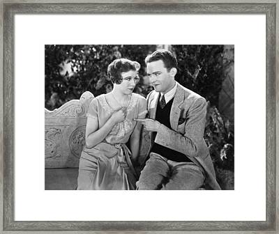 A Couple Flirting Framed Print by Underwood Archives