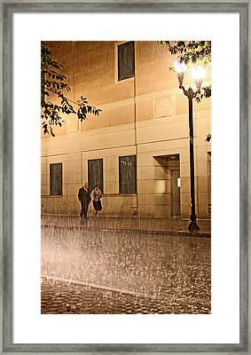 A Couple In The Rain Framed Print by Chris Fender