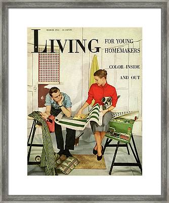 A Couple Looking At Wall Paper Framed Print
