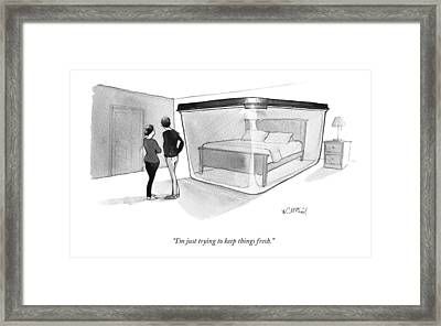 A Couple Looks At A Bed Encased In A Giant Framed Print