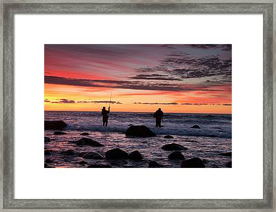 A Couple Of Fishermen Catch A Good Framed Print by Robbie George