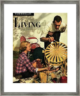 A Couple Painting A Chair Framed Print