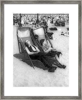 A Couple Sleeps At The Beach Framed Print