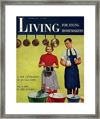A Couple Standing Next To Ekco Products Cooking Framed Print by Phillipe Halsman
