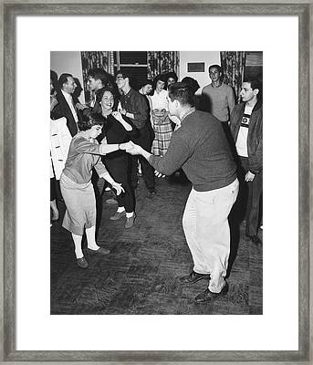 A Couple Swing Dancing Framed Print by Underwood Archives