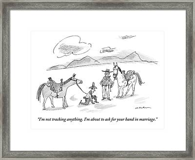 A Cowboy Is Down On One Knee Framed Print by Michael Maslin
