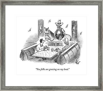 A Cowboy On A Horse Looks Into A Restaurant Framed Print